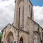 The Catholic Holy Rosary church in main square, Sapa town, Lao C — Stock Photo #77831792