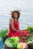 Funny woman with vegetables in a boat — Stock Photo