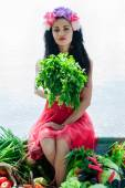 Woman sitting on the boat with parsley in hand — Stock Photo