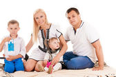 Caucasian family with little children — Стоковое фото