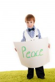 Little boy standing with the inscription peace — Stock Photo