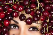 Brown eyes woman in cherry — Stock Photo