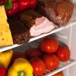 Fridge with food — Stock Photo #63096403