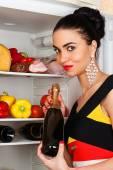 Brunette woman and a fridge — Stock Photo