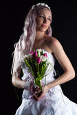 Beautiful woman with a bouquet of tulips — Stock Photo