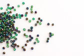 Colorful beads on a white background — Stock Photo