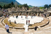 Tourists on Amphitheater (Coliseum) in Ephesus Turkey on April 13, 2015. Ephesus contains the ancient largest collection of Roman ruins in the eastern Mediterranean. — Stock Photo