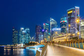 Singapore business buildings area at night on July 10, 2015 in Singapore. Singapore is a world famous tourist city with highly developed economic infrastructure. — Stock Photo