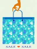 Hand holding baby shopping bag with toy and cloth icons — Stock Vector