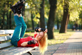 Roller sporty girl in park, woman outdoor fitness activities — Stock Photo