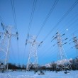 Electricity pylons and power high voltage power tower in winter  — Stock Photo #63906609