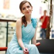 Beautiful young woman in a long blue dress in anticipation — Stock Photo #69894201