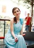 Beautiful young woman in a long blue dress in anticipation — Стоковое фото