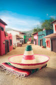 """Mexican hat on a """"serape"""" in  village — Stock Photo"""