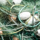 Nylon Commercial Fishing Net Tangled with Ropes and Floats — Stock Photo