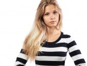 Girl in a striped sweater tired — Stock Photo