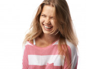 Pretty girl  expressively laughs — Stock Photo