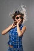 Girl in a hat surprised and her hair fluttering — 图库照片