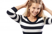Beautiful girl in a striped sweater cute smiling — Stock Photo