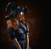 Beautiful red-haired girl in the witch costume — Stock Photo