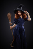 Beautiful red-haired girl in a  costume witch — Foto Stock