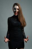 Beautiful woman with makeup skeleton — Stock Photo