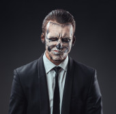 Incredulous businessman with makeup skeleton — Stock Photo
