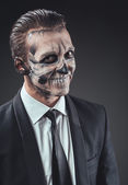 Cunning businessman with a makeup of the skeleton — Stock Photo