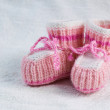 Knitted pink baby boots — Stock Photo #62611395
