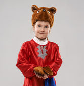 Red-haired girl in a suit of the Slavic bear — Stock Photo