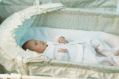 Little baby sleeping in the manger — Stock Photo