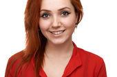 Redhead  girl smiles sweetly — Stock Photo
