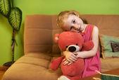 Beautiful girl loves  teddy bear — Stock Photo