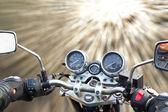 Motorbike rides on the street — Stock Photo