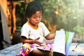 Curious Little Baby with a Book — Stock Photo