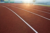 Running racetrack constructed from red rubber cover — Stock Photo