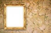 Blank golden frame on whtie cement wall  — Zdjęcie stockowe
