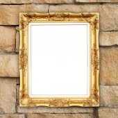 Blank golden frame on brick stone wall — Stock Photo