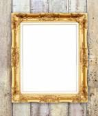 Blank golden frame on wood wall — Zdjęcie stockowe
