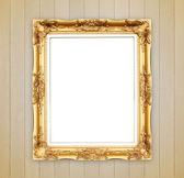 Blanc cadre doré sur cloison en bois — Photo