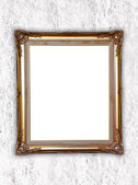 Golden frame on whtie cement wall  — Stock Photo