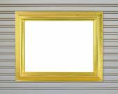 пустой золотой кадр на металлической стене — Стоковое фото