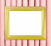 Blank golden frame on bamboo wall  — Stock Photo