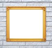 Blank golden frame on brick stone wall  — Zdjęcie stockowe