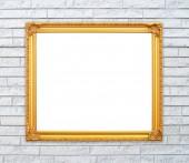 пустой золотой кадр на каменной стене кирпич — Стоковое фото