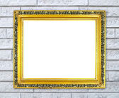 Blank golden frame on brick stone wall  — Stock Photo