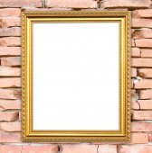 Blank golden frame on brick stone wall  — 图库照片
