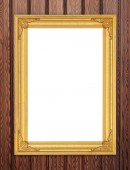 Blank golden frame on wood wall — Stock Photo