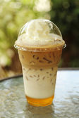 Ice coffee with whipping cream — Stock Photo