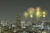 Fireworks celebrating over Tokyo cityscape at night — Stock Photo